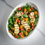 Chickpea and tomato salad, with grilled halloumi